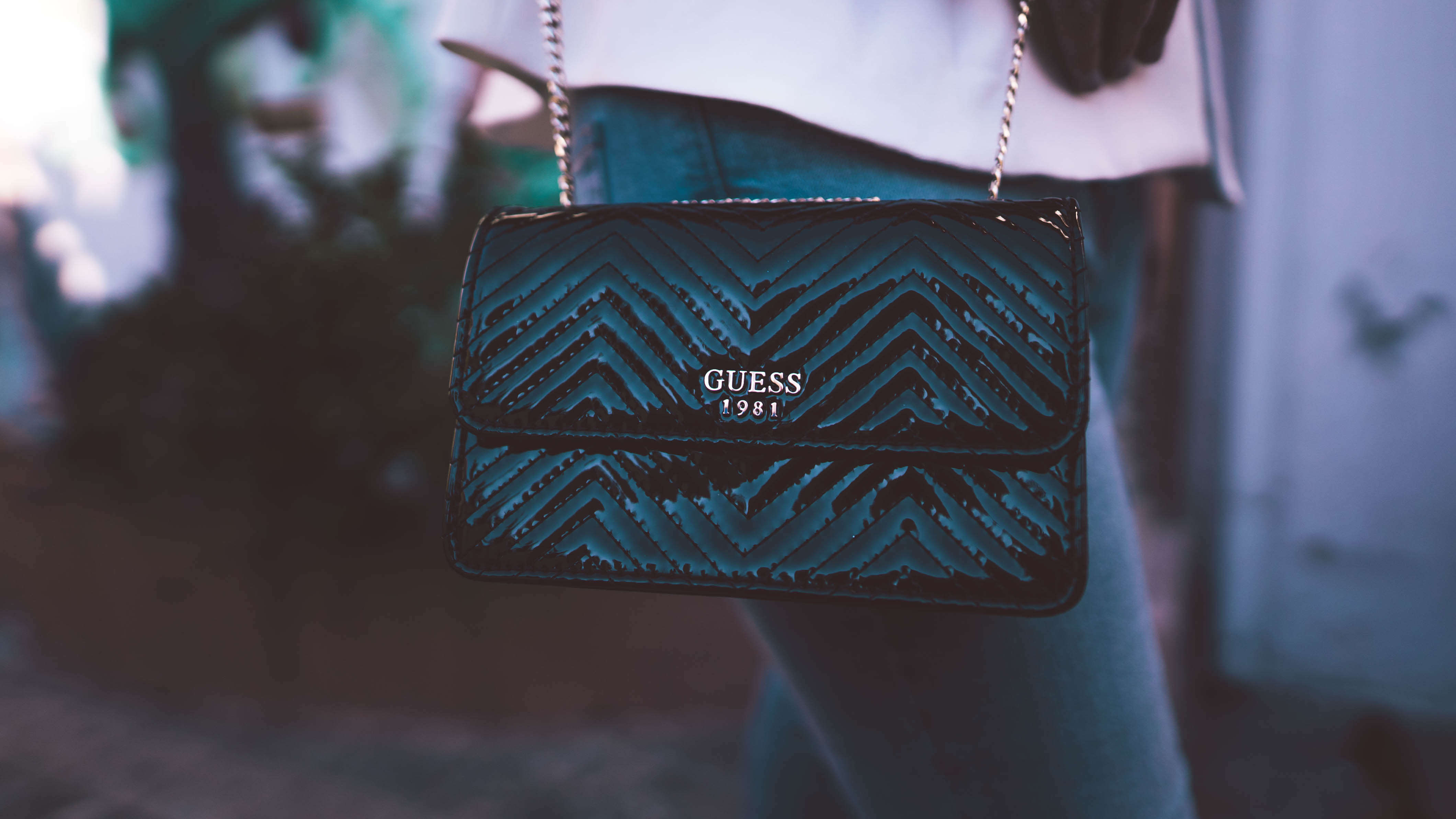 Fashionista in the city close up guess black bag